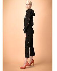 Spodnie z ozdobnymi guzikami Megafono