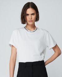 T-shirt z łańcuchem