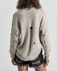 Sweter wełniany z dziurami