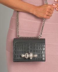 Skórzana torebka z pierścieniami