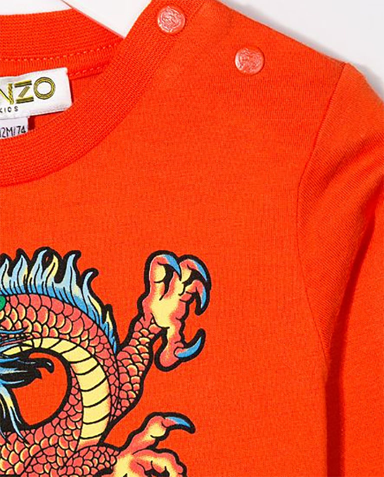 Pomarańczowa koszulka ze smokiem 0-4 lata