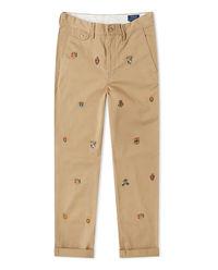 Beżowe spodnie z naszywkami