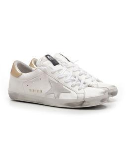 Sneakersy Superstar ze złotą piętą