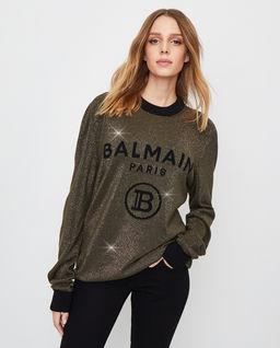 Błyszczący sweter z logo