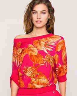 Asymetryczny  sweter z motywem liści