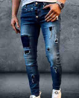 Niebieskie jeansy z dziurami Furious