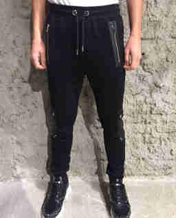 Spodnie z aplikacjami ze skóry