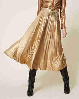 Złota plisowana spódnica