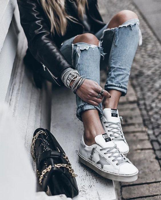 Dziewczyna w sneakersach Golden Goose