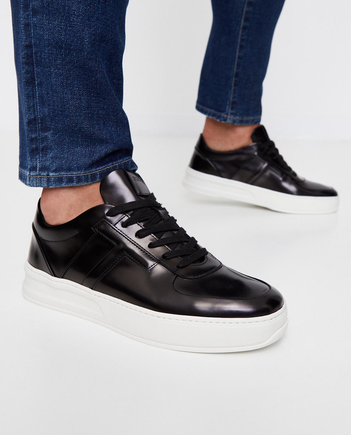 Czarne sneakersy z błyszczącej skóry Tod's XXM79B0BS10AKTB999
